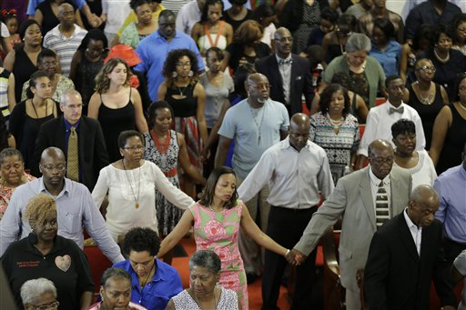 Parishioners sing at the Emanuel A.M.E. Church Sunday, June 21, 2015, in Charleston, S.C., four days after a mass shooting that claimed the lives of it's pastor and eight others. (AP Photo/David Goldman, Pool)