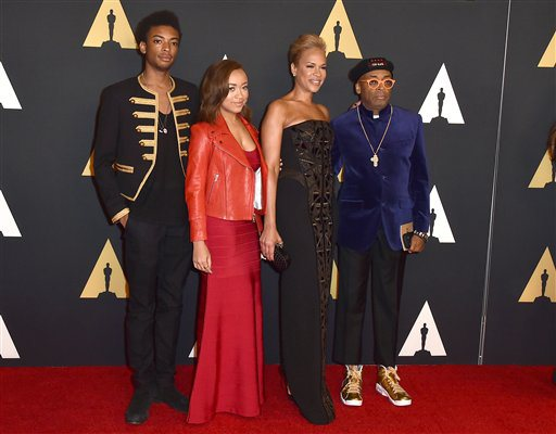 Spike Lee, from right, Tonya Lewis Lee, Satchel Lee and Jackson Lee arrive at the Governors Awards at the Dolby Ballroom on Saturday, Nov. 14, 2015, in Los Angeles. (Photo by Jordan Strauss/Invision/AP)