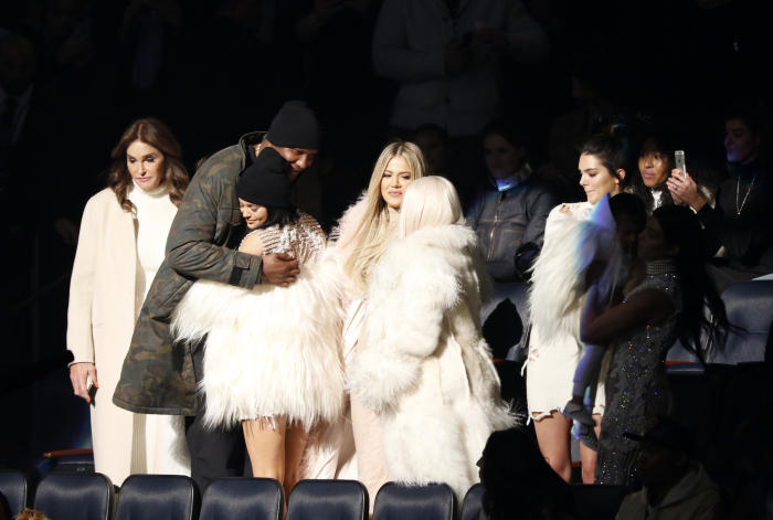 "Lamar Odom, second left, hugs Kylie Jenner as Caitlyn Jenner, left, Khloe Kardashian Odom, center, Kim Kardashian, Kendall Jenner, North West and Kourtney Kardashian (both out of spotlight) attend the unveiling of the Yeezy collection and album release for Kanye West's latest album, ""The Life of Pablo,"" Thursday, Feb. 11, 2016 at Madison Square Garden in New York. (AP Photo/Bruce Barton)"